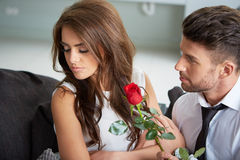 Portrait of two young people holding a rose Royalty Free Stock Photography