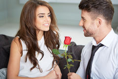 Portrait of two young people holding a rose Stock Images