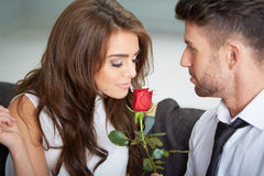 Portrait of two young people holding a rose Royalty Free Stock Photo