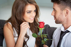 Portrait of two young people holding a rose Royalty Free Stock Photos