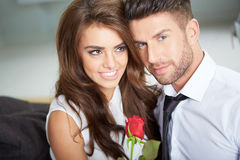 Portrait of two young people holding a rose Stock Photography