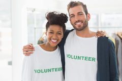 Portrait of two young volunteers with arms around Stock Photography