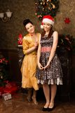Portrait of two young woman posing  at New Year eve. Royalty Free Stock Images