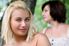 Portrait of two young women Stock Photos