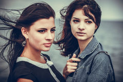 Portrait of two young women Stock Image