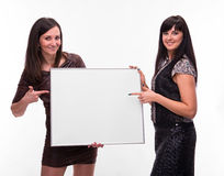 Portrait of two young women with billboard Royalty Free Stock Photos
