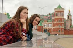 Portrait of two young women in casual wear on a walk around the city, standing and looking at the camera.  Stock Image