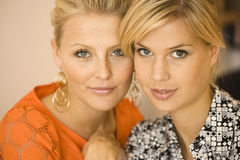 Portrait of two young women. Close up portrait of two young women Stock Image