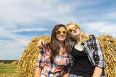 Portrait of two young women at field background Stock Photo