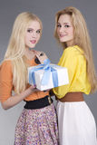 Portrait of two young women with a gift box Stock Photo