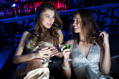 Portrait of two young women at restaurant Stock Photography