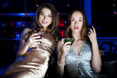 Portrait of two young women at restaurant Royalty Free Stock Photos