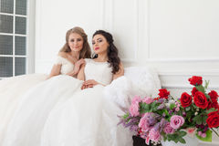Portrait of two young women in wedding dresses in White Hall stock photos