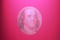 Portrait of  U.S. president Benjamin Franklin. On pink Royalty Free Stock Photos