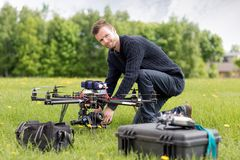 Portrait of an UAV Aerial Photography. An UAV pilot and photographer prepares his copter for flight stock photo