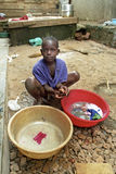 Portrait of Ugandan boy washing clothes Royalty Free Stock Photo