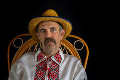 Portrait of Ukrainian country-man sitting in a wicker chair Stock Images