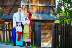Portrait of ukrainian family dressed in traditional costumes near the house Royalty Free Stock Photo