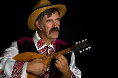 Portrait of Ukrainian farmer playing mandolin Stock Photo