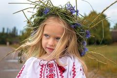 Portrait of ukrainian girl in chaplet. Emotional portrait of ukrainian girl in flower chaplet Stock Photos