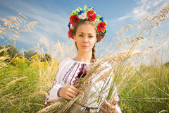 Portrait of ukrainian woman in wreath at wheat field Stock Images