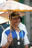 Portrait of a Umbrella Seller in Bangkok Stock Images