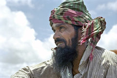 Portrait of unhappy Bangladeshi peasant. Bangladesh, Charburhan village on the island of Charkajal, Bay of Bengal closeup of Bangladeshi farmer, man, with beard stock photo