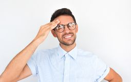 Portrait of unhappy Caucasian man standing with closed eyes wearing spectacles holding hand on head looking stressful. Stressed stock photos
