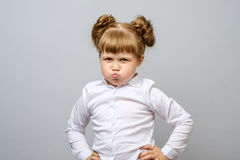 Portrait of unhappy little girl. Isolated Royalty Free Stock Photos