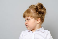 Portrait of unhappy little girl. Isolated Royalty Free Stock Photography