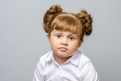 Portrait of unhappy little girl. Isolated Stock Image