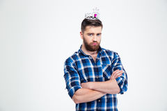 Portrait of unhappy man with queen crown Stock Photos