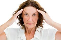Portrait of unhappy mature woman having headache Royalty Free Stock Photography