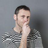 Portrait of unhappy 40s man looking skeptical Stock Images