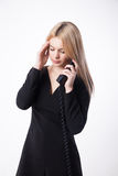 Portrait unhappy young woman talking on phone looking down Stock Photos