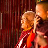 Portrait of unidentified Buddhist monk near stupa Boudhanath Stock Image