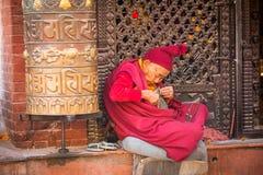 Portrait of unidentified Buddhist monk near stupa Boudhanath Royalty Free Stock Photography