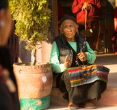 Portrait of unidentified old woman near stupa Boudhanath. royalty free stock photos