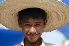 Portrait of unidentified young man wearing a straw hat in Taizz, Yemen. Stock Images