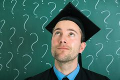Portrait of university student looking up. Infront Of Black Board Royalty Free Stock Photos