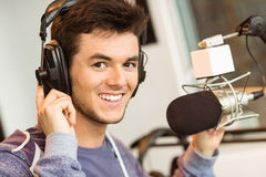 Portrait of an university student recording audio. In a studio of a radio Royalty Free Stock Photography