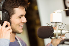 Portrait of an university student recording audio. In a studio of a radio Stock Photos