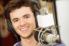 Portrait of an university student recording audio Royalty Free Stock Image