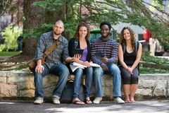 Portrait Of University Students Sitting On Campus Royalty Free Stock Photo