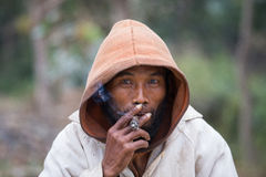 Portrait of an unknown beggar who smokes a cigarette Royalty Free Stock Photo
