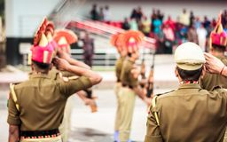 Portrait of unrecognizable indian policeman saluting each other royalty free stock image