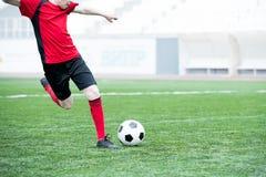 Football Player Kicking Ball royalty free stock photography