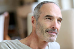 Portrait of unshaved senior man at home Royalty Free Stock Photography