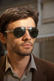 Portrait of an unshaven man model with sunglasses Stock Photography