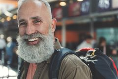 Old man demonstrating cheerfulness in airport Royalty Free Stock Images